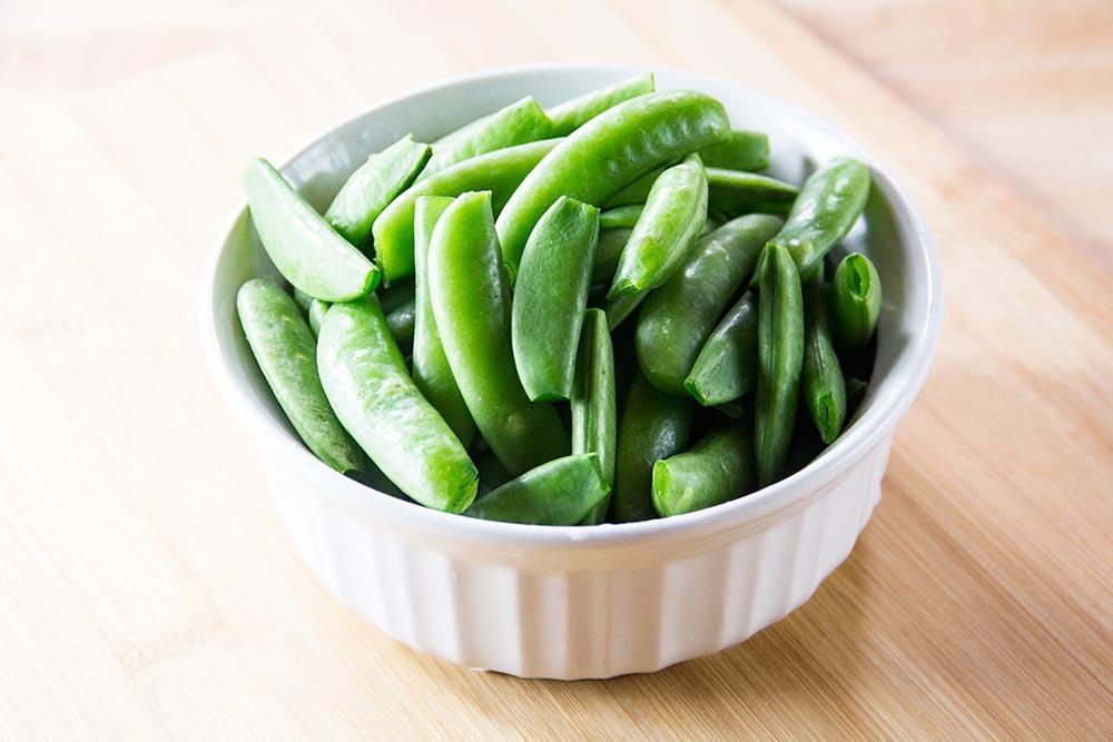 Sugar Snap Peas in Bowl on Cutting Board