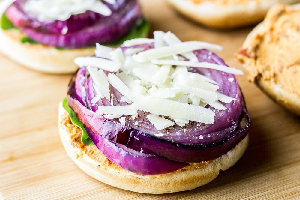 Adding Shredded Asiago Cheese to the Portobello Burger