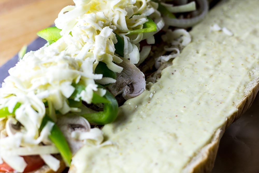 Adding Mozzarella Cheese to Sandwich