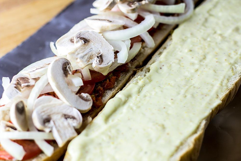 Adding Mushrooms to Sandwich