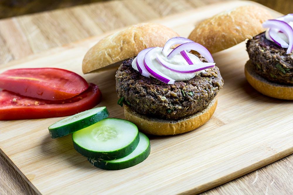 Assembling Veggie Burgers on Cutting Board
