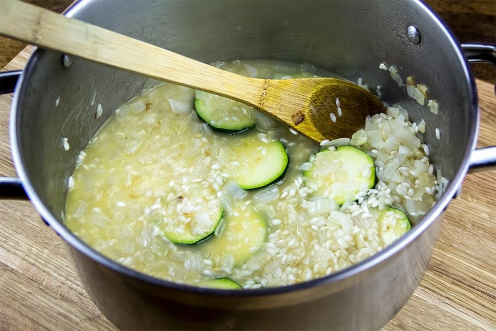 Adding Zucchini to Risotto in Saucepan