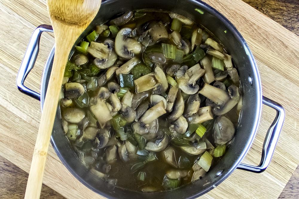 Mushroom Soup Simmering in Broth