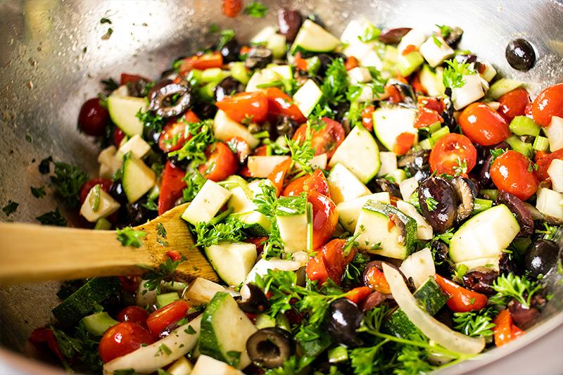 Mixing Pasta Salad Ingredients in Bowl