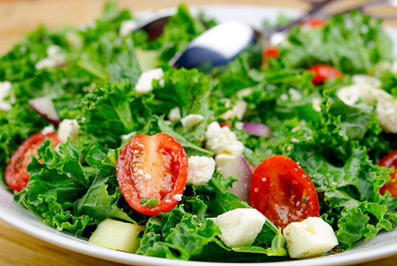 Kale Greek Salad In A White Bowl